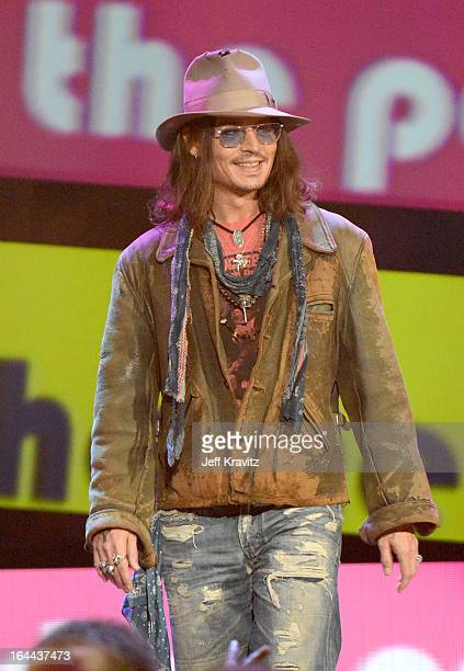 Actor Johnny Depp speaks onstage at Nickelodeon's 26th Annual Kids' Choice Awards at USC Galen Center on March 23 2013 in Los Angeles California