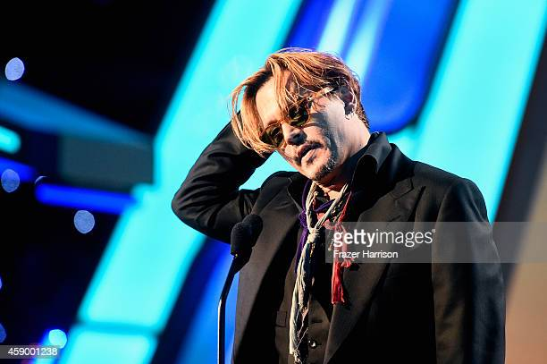 Actor Johnny Depp speaks onstage during the 18th Annual Hollywood Film Awards at The Palladium on November 14 2014 in Hollywood California
