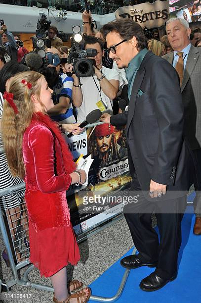 Actor Johnny Depp talks with School girl Beatrice Delap as he arrives for the UK Premiere of 'Pirates Of The Caribbean On Stranger Tides' at Vue...