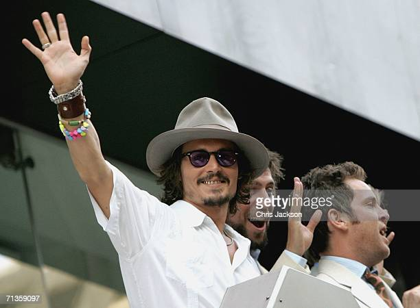 Actor Johnny Depp waves from the balcony of the Odeon cinema at the European Premiere of 'Pirates Of The Caribbean Dead Man's Chest' at the Odeon...