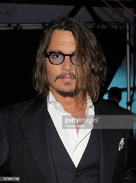 Actor Johnny Depp winner of the Favorite Movie Actor award for 'Alice in Wonderland' attends the 2011 People's Choice Awards at Nokia Theatre LA Live...