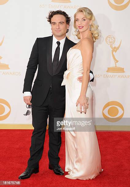 Actor Johnny Galecki and actress Kelli Garner arrive at the 65th Annual Primetime Emmy Awards at Nokia Theatre LA Live on September 22 2013 in Los...