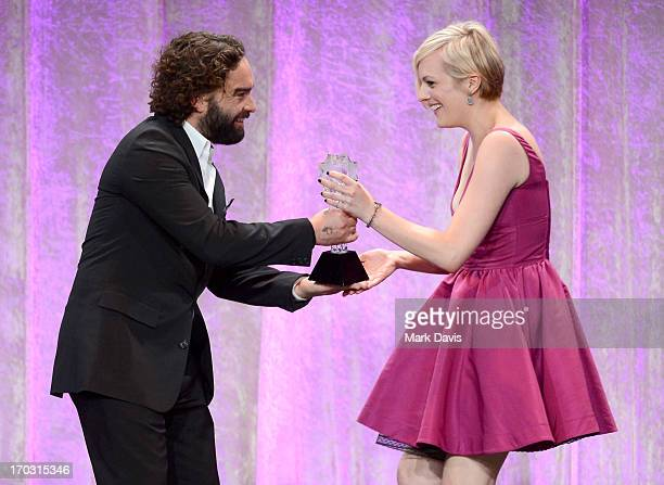 Actor Johnny Galecki presents the Best Actress in a Movie or Miniseries award for Top of the Lake to Elisabeth Moss onstage during Broadcast...