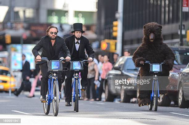 Actor Johnny Galecki races a Citibike against cast member at the Late Show With David Letterman taping at the Ed Sullivan Theater on June 5 2013 in...