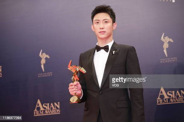 Actor Johnny Huang Jingyu poses backstage during the 13th Asian Film Awards on March 17 2019 in Hong Kong China