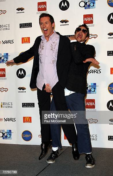 Actor Johnny Knoxville one of the evening's award presenters and Rove fool around backstage in the Awards Room at the ARIA Awards 2006 at the Acer...