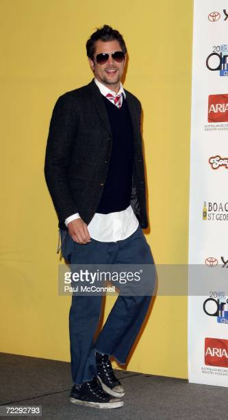 Actor Johnny Knoxville one of the evening's award presenters poses backstage in the Awards Room at the ARIA Awards 2006 at the Acer Arena on October...