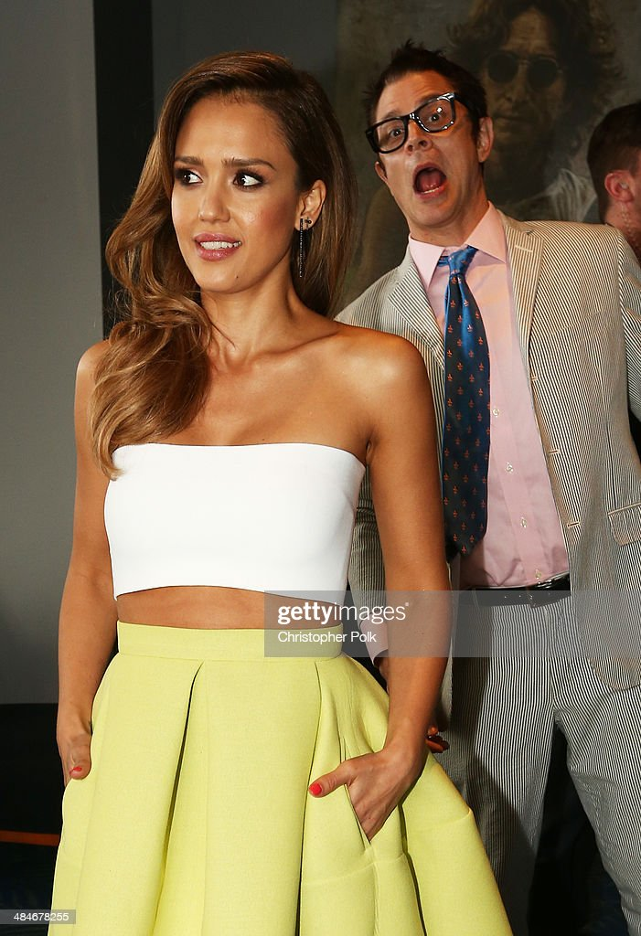 Actor Johnny Knoxville (R) photobombs actress Jessica Alba at the 2014 MTV Movie Awards at Nokia Theatre L.A. Live on April 13, 2014 in Los Angeles, California.