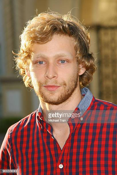 Actor Johnny Lewis arrives to the Sons of Anarchy Season 2 premiere screening held at the Paramount Theater on the Paramount Studios lot on August 23...