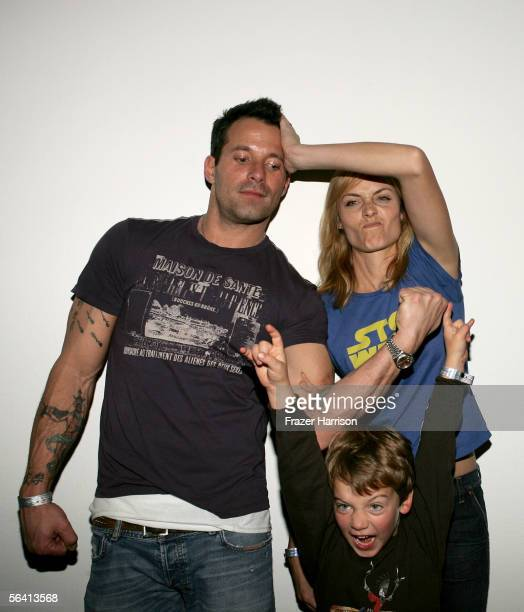 Actor Johnny Messner actress Amber Valletta and son Auden McCaw attend Playstation BANDtogether a benefit presented by Sony Computer Enterainment...
