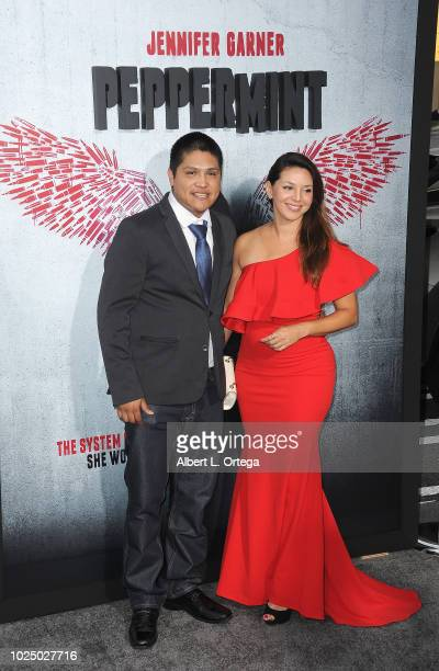 Actor Johnny Ortiz and Diana Hernandez arrive for the Premiere Of STX Entertainment's Peppermint held at Stadium 14 on August 28 2018 in Los Angeles...