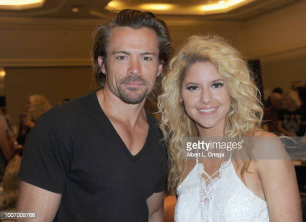 Actor JohnPaul Lavoisier and actress Brittany Underwood attend The Hollywood Show held at The Westin Hotel LAX on July 28 2018 in Los Angeles...