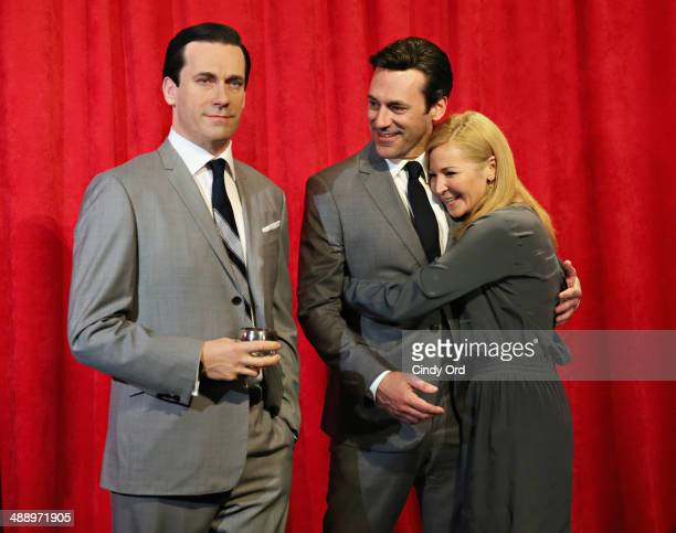 Actor Jon Hamm and actress Jennifer Westfeldt pose next to Don Draper's wax figure as Madame Tussauds New York unveils it during Mad Men's Final...
