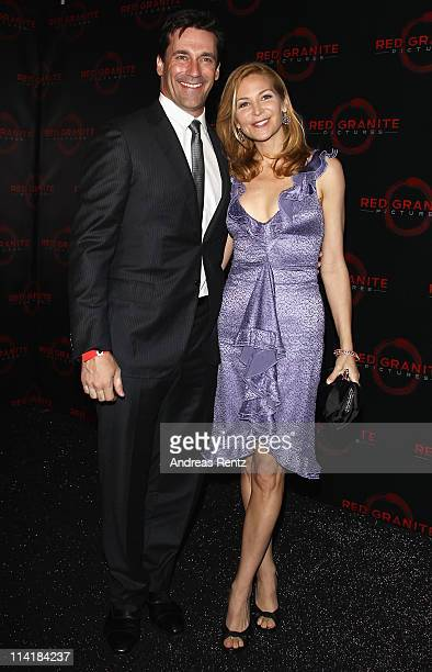 Actor Jon Hamm and director Jennifer Westfeldt attend the Red Granite Party during the 64th Annual Cannes Film Festival at Carlton Beach on May 14...