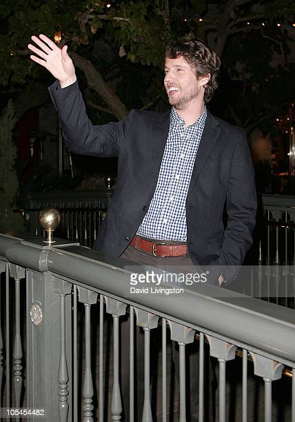 Actor Jon Heder tosses a coin into The Grove's Dancing Fountain during ''A Taste of Italy'' on January 28 2010 in Los Angeles California The event...