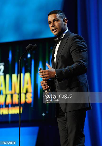 Actor Jon Huertas accepts the Favorite TV Actor Supporting Role in a Drama award at the 2012 NCLR ALMA Awards PreShow at Pasadena Civic Auditorium on...