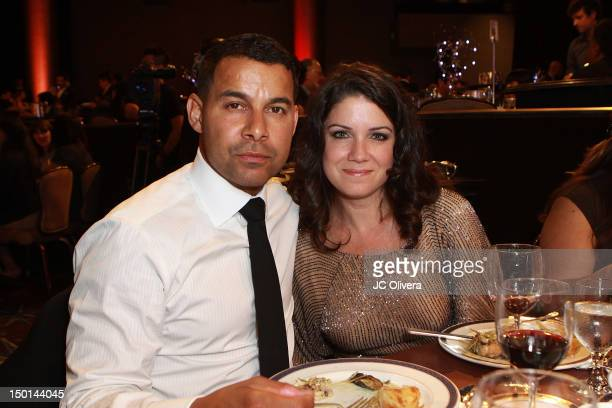 Actor Jon Huertas and his wife attend the 27th Annual Imagen Awards at The Beverly Hilton Hotel on August 10 2012 in Beverly Hills California