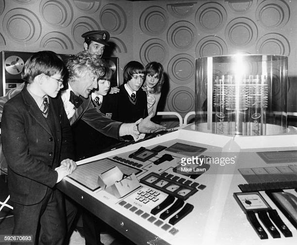 Actor Jon Pertwee in costume as 'Dr Who' showing his TARDIS to a group of school children from Pimlico Mixed Comprehensive at the Special Effects...