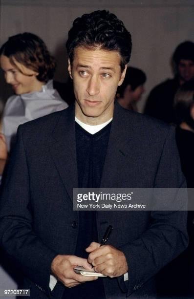 Actor Jon Stewart is taking note backstage at designer Mark Eisen's spring/summer 1999 fashion show at the Chelsea Piers