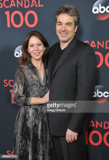 Actor Jon Tenney and wife Leslie Urdang arrive at ABC's Scandal 100th Episode Celebration at Fig Olive on April 8 2017 in West Hollywood California