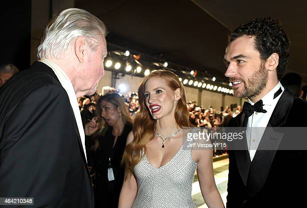 Actor Jon Voight actress Jessica Chastain and Gian Luca Passi de Preposulo attend the 2015 Vanity Fair Oscar Party hosted by Graydon Carter at the...