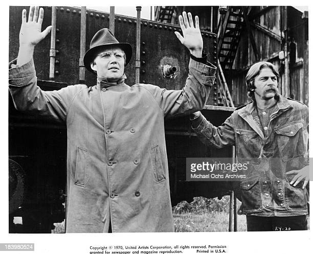 Actor Jon Voight and actor Seymour Cassel on set of the United Artists movie The Revolutionary in 1970