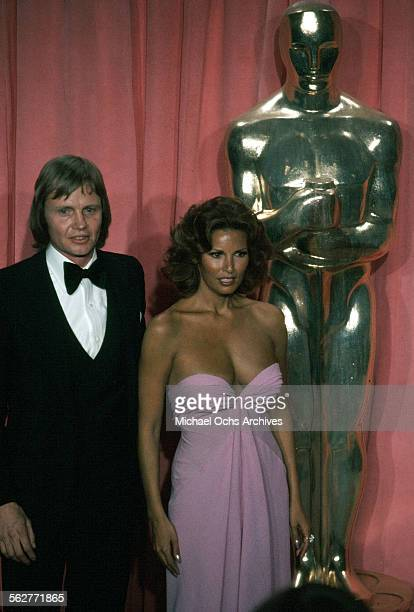 Actor Jon Voight and actress Raquel Welch poses backstage after presenting Best Cinematography award during the 47th Academy Awards at Dorothy...