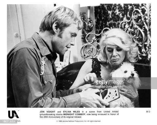 Actor Jon Voight and actress Sylvia Miles on the set of United Artists movie ' Midnight Cowboy' in 1969