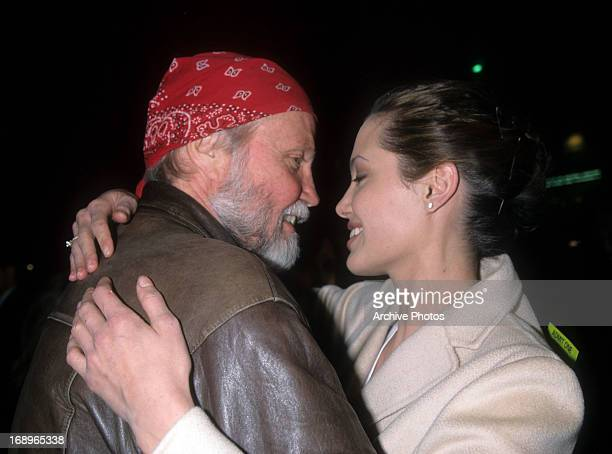 Actor Jon Voight and daughter/actress Angelina Jolie arrive at the 1998 premiere of 'Playing by Heart' on December 10 1998 in Beverly Hills California