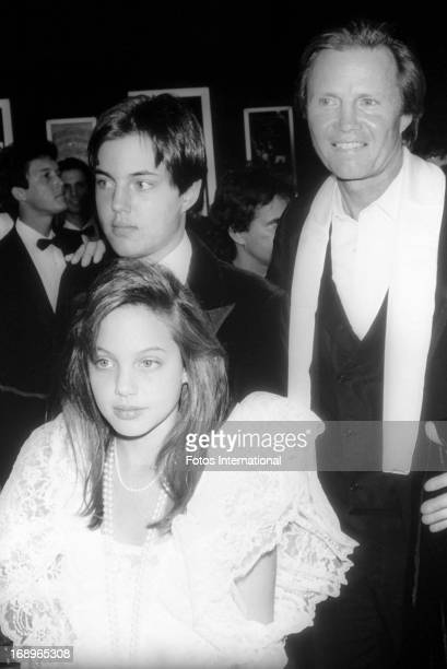 Actor Jon Voight and his son James Haven and daughter Angelina Jolie arrive for the 58th Academy Awards honoring the best in film for 1985 on March...