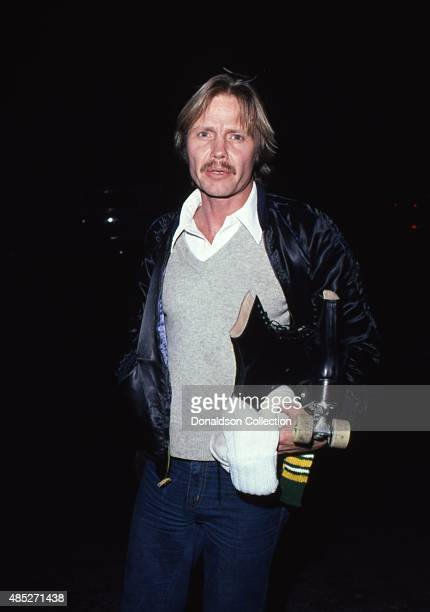 Actor Jon Voight attends an event holding a pair of roller skates in September 1980 in Los Angeles California