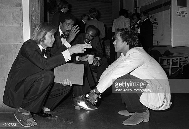 Actor Jon Voight standup comedian and actor Richard Pryor Unidentified and comedian actor Chevy Chase backstage during a tribute to Muhammad Ali...