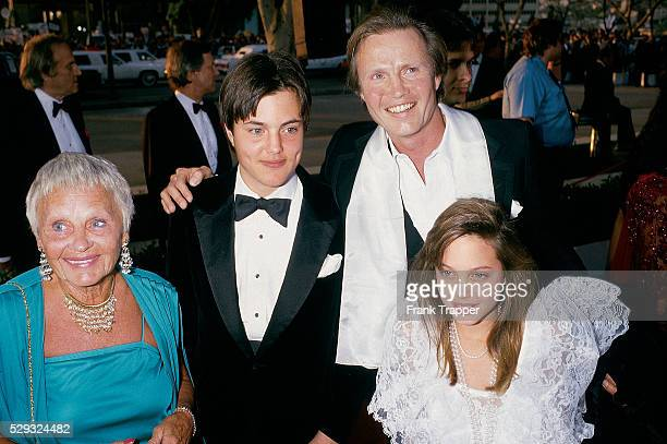 Actor Jon Voight with son James Haven daughter Angelina Jolie and mother Barbara Kamp arrive at the 1986 Academy Awards�� This photo appears on pages...