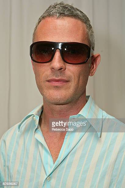 Actor Jon Wolfe Nelson poses with the Beryll Eyewear display during the HBO Luxury Lounge in honor of the 60th annual Primetime Emmy Awards featuring...