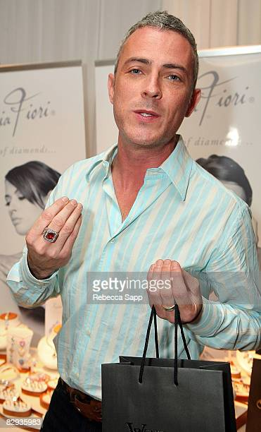 Actor Jon Wolfe Nelson poses with the Sophia Fiori Diamond Jewelry display during the HBO Luxury Lounge in honor of the 60th annual Primetime Emmy...