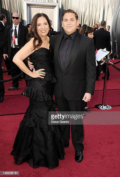 Actor Jonah Hill and guest arrive at the 84th Annual Academy Awards held at the Hollywood Highland Center on February 26 2012 in Hollywood California