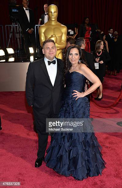 Actor Jonah Hill and Sharon Lyn Chalkin attend the Oscars held at Hollywood Highland Center on March 2 2014 in Hollywood California