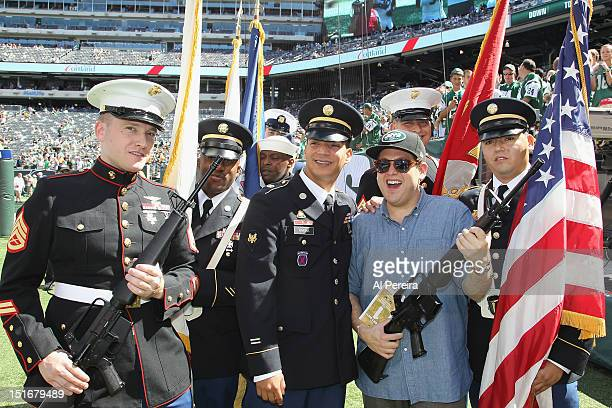 Actor Jonah Hill poses with US Servicemen when he attends the Buffalo Bills vs New York Jets game at MetLife Stadium on September 9 2012 in East...