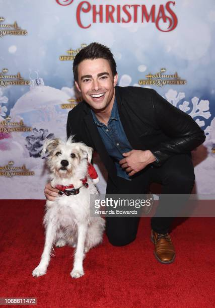 Actor Jonathan Bennett and Happy the Dog arrive at the Hallmark Channel 'Once Upon A Christmas Miracle' screening and holiday party at 189 by...