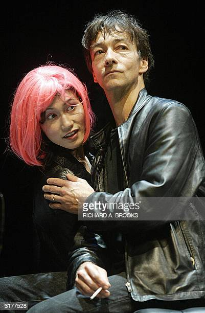 Actor Jonathan Douglas in the role of Hamlet is seen with actress Jessica Leung at the Shouson theatre in Hong Kong 31 March 2004 in a new adaptation...