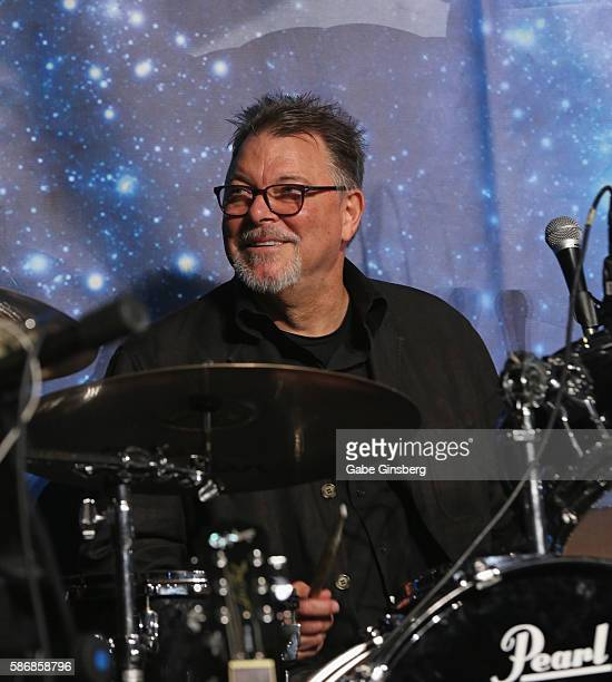 Actor Jonathan Frakes poses on a drumset during the 'Star Trek The Next Generation Stars Part 3' panel at the 15th annual official Star Trek...