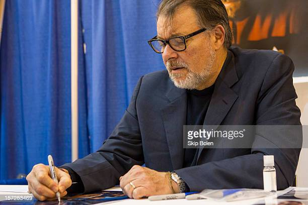 Actor Jonathan Frakes signs an autograph for a fan at Wizard World New Orleans Comic Con 2012 at Ernest N Morial Convention Center on November 30...