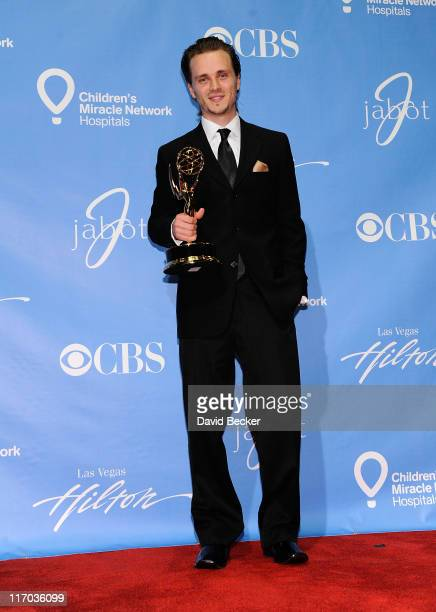 Actor Jonathan Jackson poses with the Outstanding Supporting Actor award in the press room at the 38th Annual Daytime Entertainment Emmy Awards held...