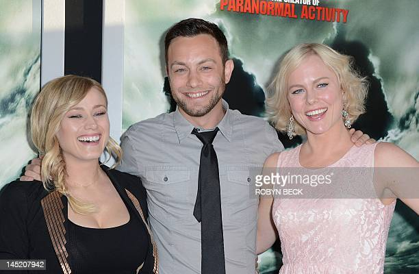 Actor Jonathan Sadowski poses with actresses Olivia Taylor Dudley and Ingrid Bolso Berdal as they arrive on the red carpet at a special screening of...