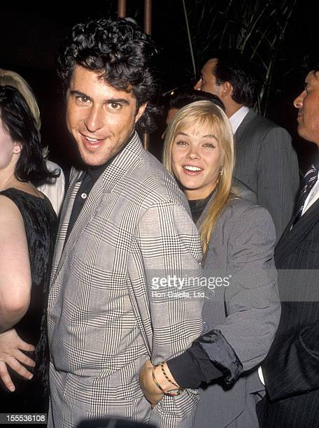 Actor Jonathan Silverman and actress Julie McCullough attend the Young Guns Hollywood Premiere on July 30, 1990 at Mann's Chinese Theatre in...