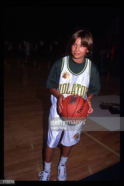 Actor Jonathan Taylor Thomas holds a basketball at MTV's Rock N Jock basketball game September 16 1995 in Los Angeles CA For the fifth straight year...