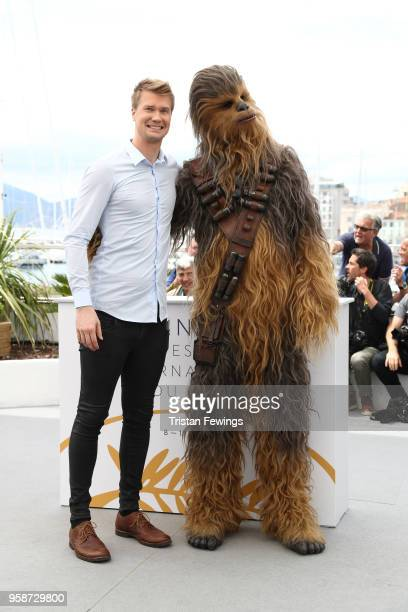 "Actor Joonas Suotamo poses with the character he plays of Chewbacca as they attend the photocall for ""Solo: A Star Wars Story"" during the 71st annual..."