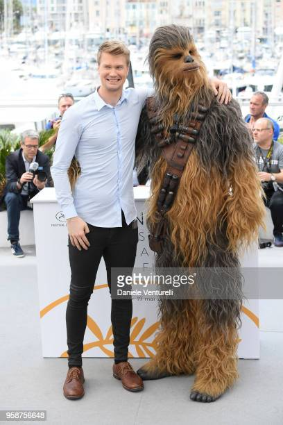 Actor Joonas Suotamo poses with the character he plays of Chewbacca as they attend the photocall for Solo A Star Wars Story during the 71st annual...