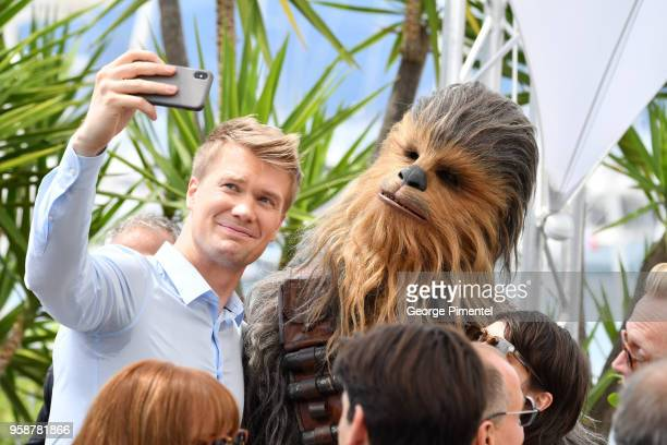 Actor Joonas Suotamo poses with the character he plays of Chewbacca as they attend the photocall for 'Solo: A Star Wars Story' during the 71st annual...