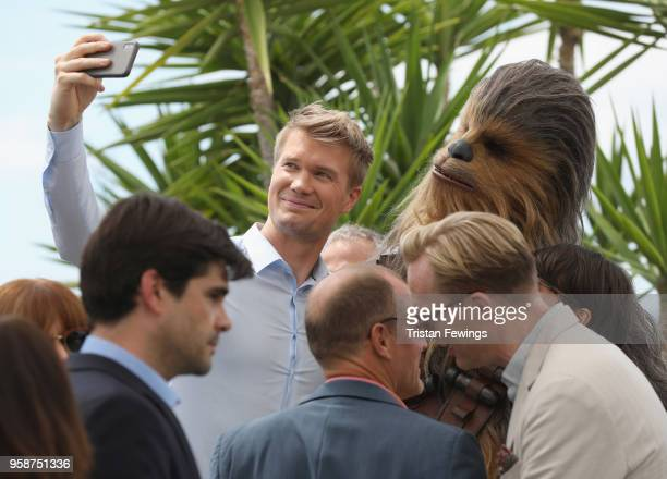 "Actor Joonas Suotamo takes a selfie with Chewbacca attends the photocall for ""Solo: A Star Wars Story"" during the 71st annual Cannes Film Festival at..."